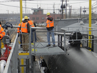 Loading Chemicals in Railcar